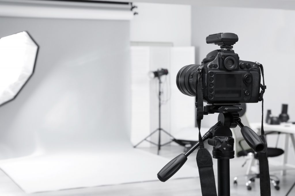 Photography studio with white backdrop