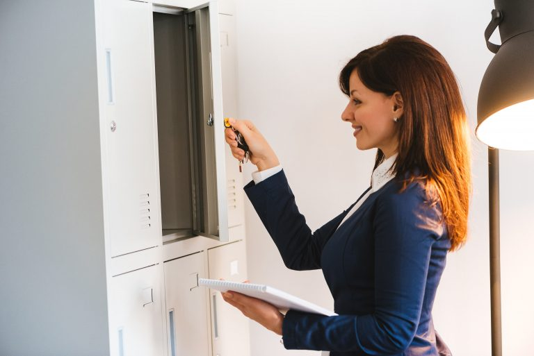 woman storing files in a cabinet
