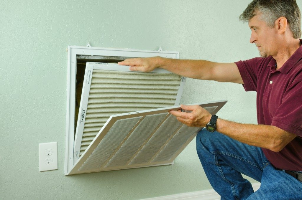 Man removing a dirty air filter