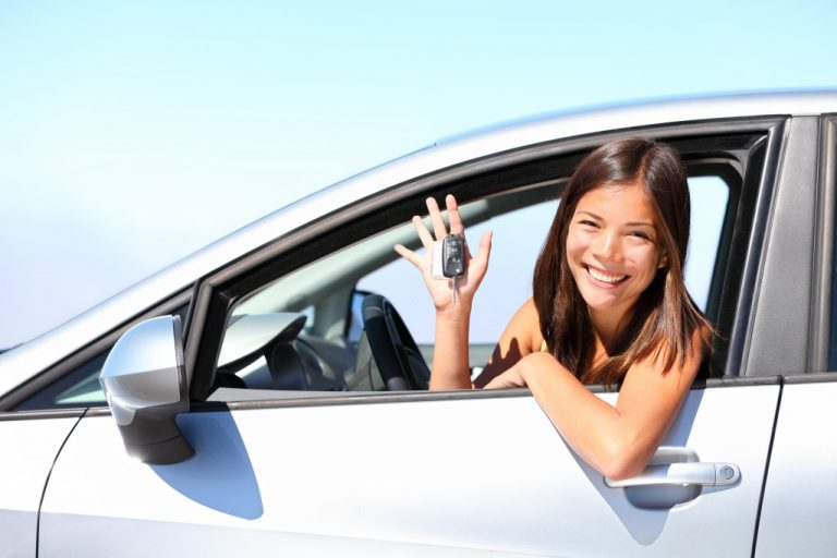 woman inside her rented car