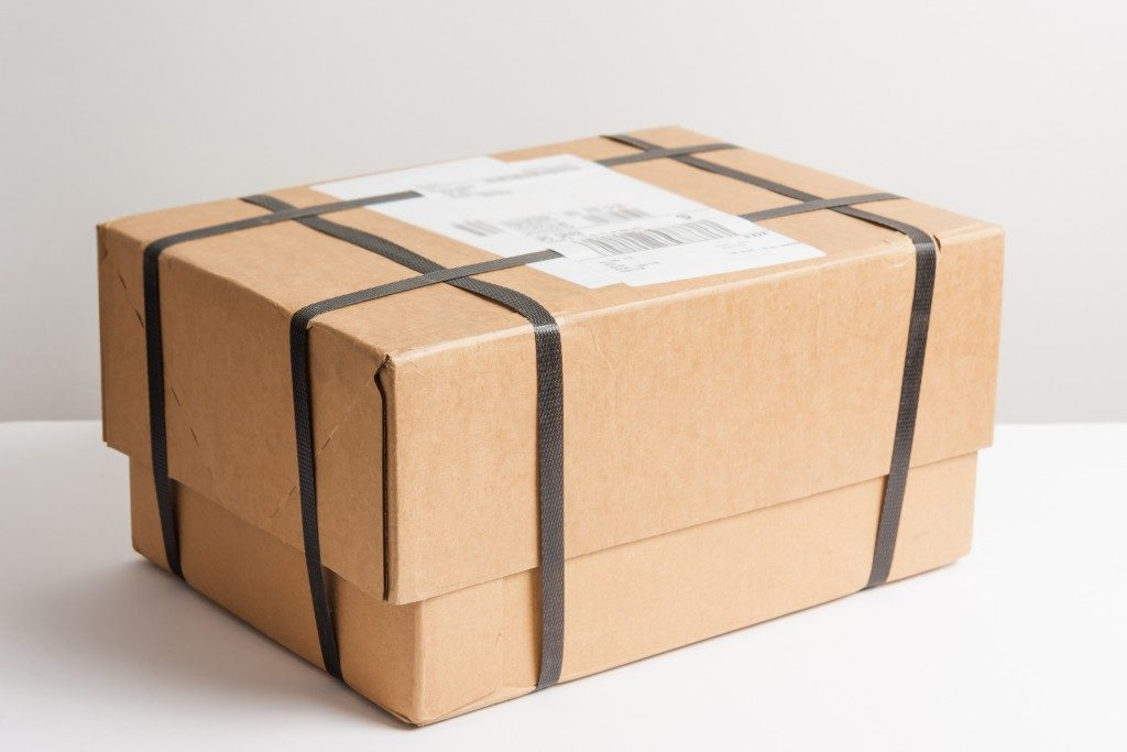Strapped parcel with white label