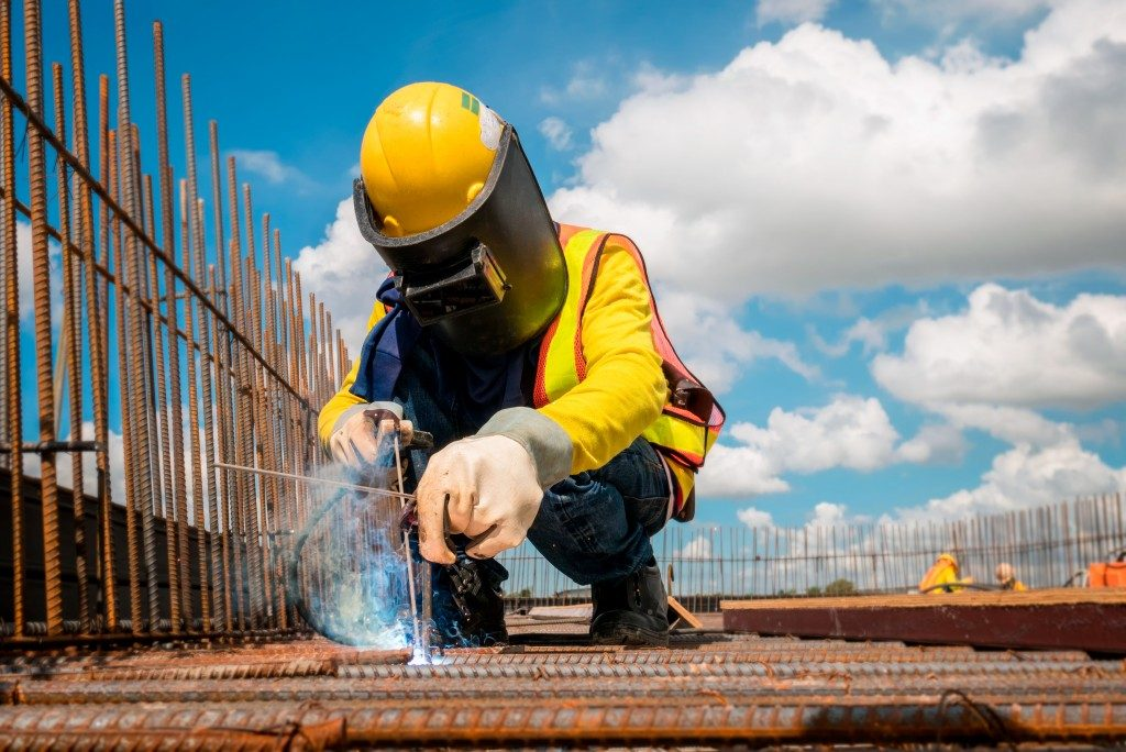 man wearing safety equipments during construction