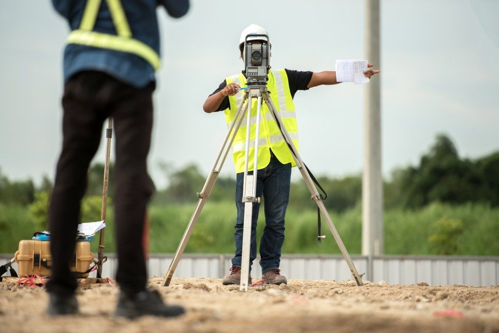 man surveying building site