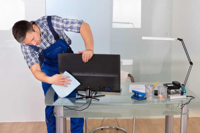Man cleaning a monitor