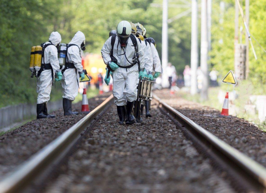 People using hazardous materials