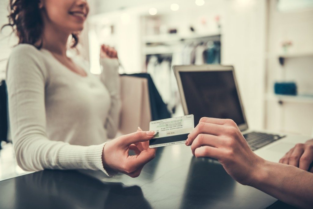 woman paying using her credit card