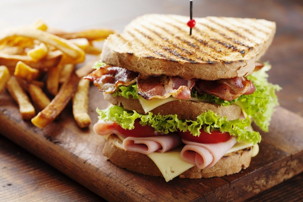 Club sandwich and fries served
