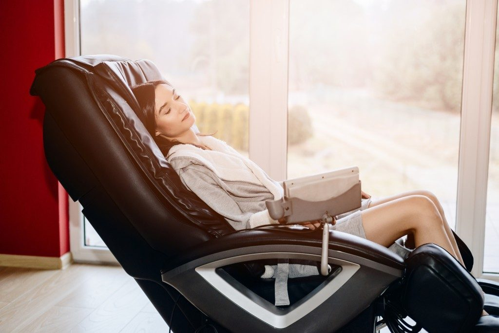 Woman sitting on a massage chair