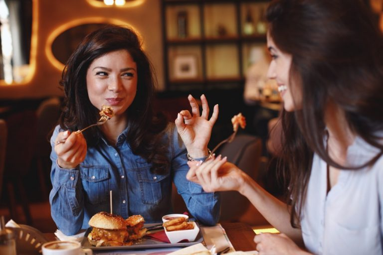 Two females eating in a restaurant