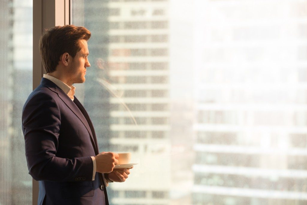 businessman looking at buildings from window