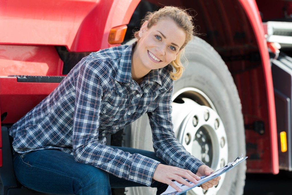 woman infront of a truck