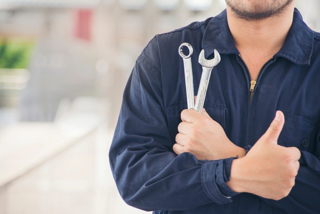 mechanic holding tools