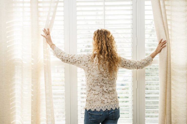 woman standing by the window