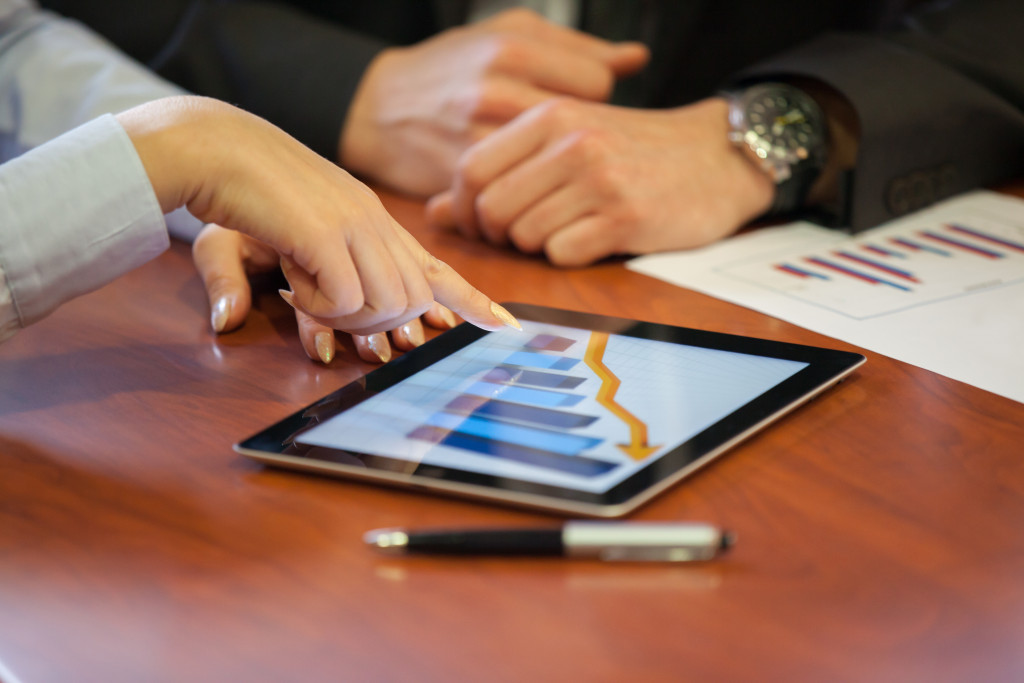 pointing to graph on tablet