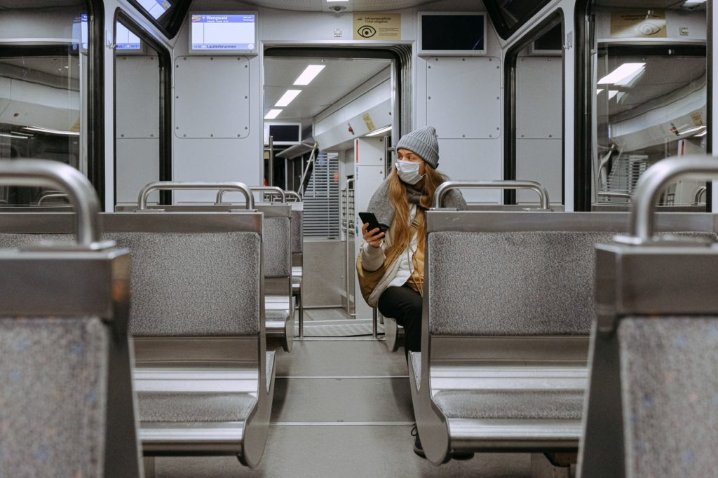 riding a train during a pandemic