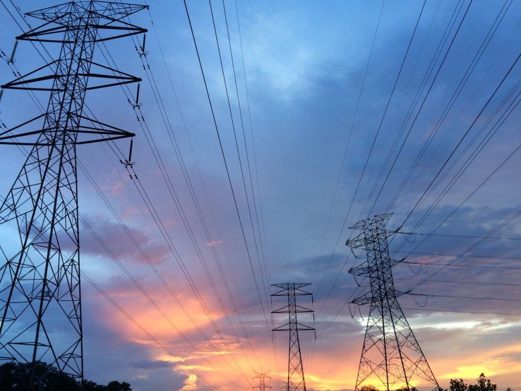 power transmission towers at dawn
