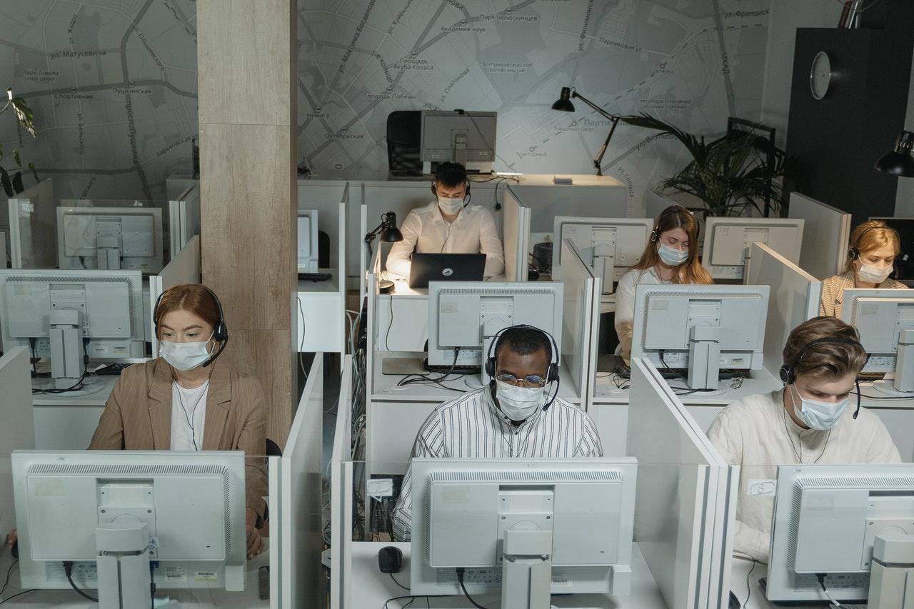 people working while wearing facemasks