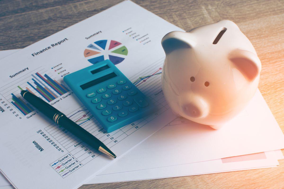 calculator piggy bank and graphs