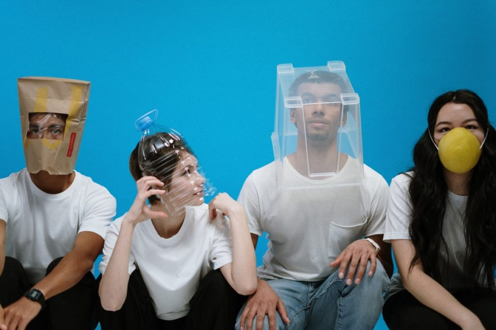 people wearing creative masks