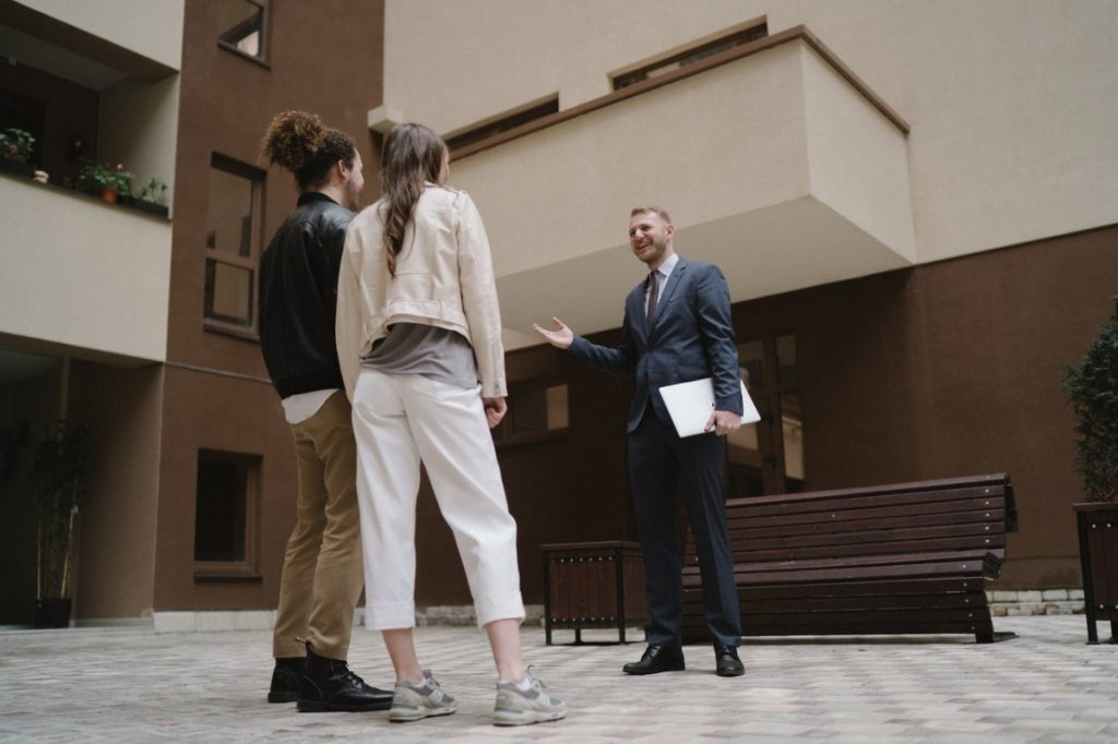 real estate agent and clients