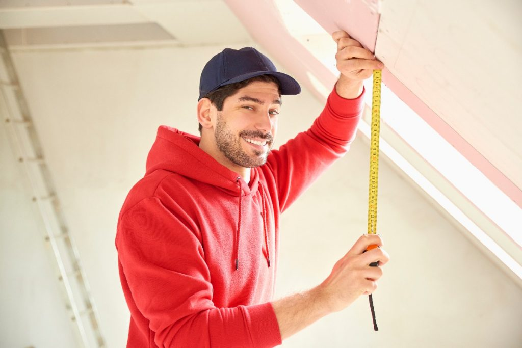man holding a tape measure