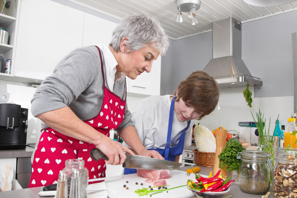 grandmother and child cooking