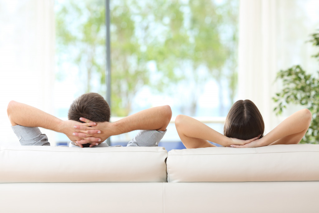 two people relaxing on the sofa
